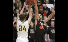 Nevis' 2,000-point scorer Griffin Chase (24) was a nightmare for B/EV down the stretch, connecting on several difficult three-point shots. Jordan Gorder's (40) near perfect defense was still not enough on this game tying shot.