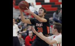 Junior forward Griffin Webster had a strong performance on Saturday, scoring a game high 22 points in the Tigers' win over Maranatha Christian Academy at the Winter  Lakes Classic showcase in Alexandria.