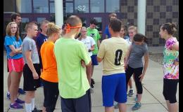 New head coach Chris Bemboom talked to his runners about weekend training as he wrapped up practice last Friday morning.