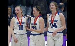 Swanville seniors Hannah Schneider (L), Emily Beseman (M), and Avery Jackson (R) react after receiving the runner-up plaque following the game.