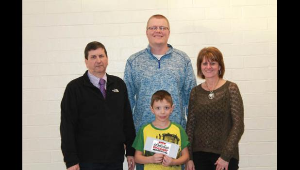 Pictured are Gene Harthan, teacher Adam Gerads, Mary Lou Gerads, and Connor Gerads, in front.