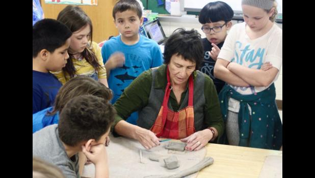 Mosaic artist Claire Witt instructed elementary students how to work with the clay pieces that will be a part of the new public art project.