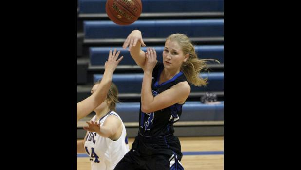 Sophomore Emma Liebsch kicked a pass out to a teammate during Thursday's game with WDC.