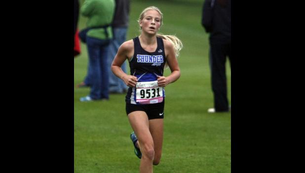 Left: Megan Och led the Thunder in the meet at Melrose and was the team's second runner at Milaca.