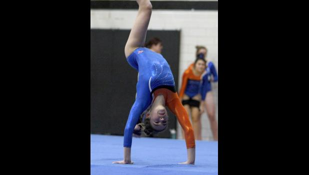 Jarrah Langner went through her floor routine during last Thursday's meet. The Wolves freshman had a good week, putting up the team's third highest points in the all-around while also leading the way on the bars.