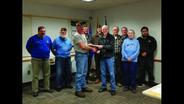 Long Prairie Mayor Don Rasmussen presented the deed to the land for the Veterans Memorial Park in downtown Long Prairie to our local veterans groups.