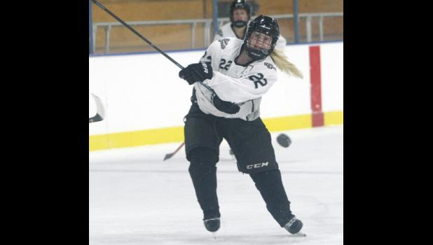 Senior wing Kenzie Christianson fired a shot on goal during the third period of play in last Friday's game with Marshall.