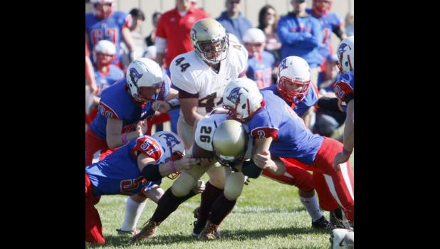 Junior lineman Dylan Vanwienen (57) and sophomore linebacker Michael Lange (2) combined for a tackle on Royalton's Cole Wentland. The two Patriots each had double digit tackles on Friday.