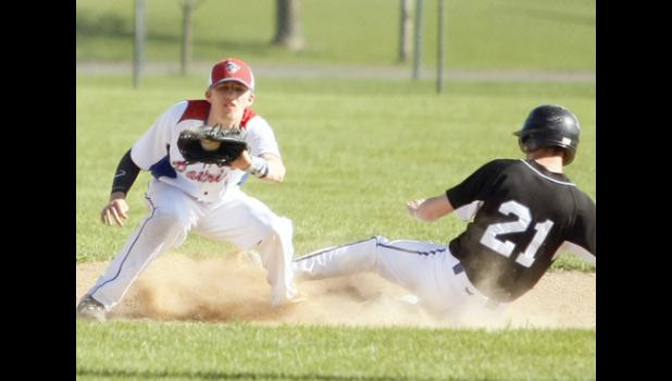LPGE's Hudson Pung (R) slid safely into second base before USA's Peyton Jackson (L) could apply the tag.