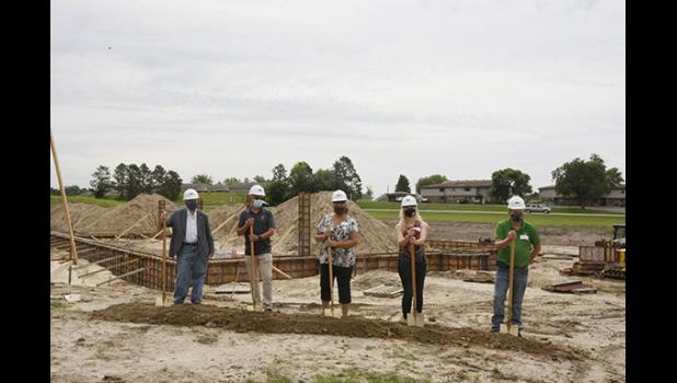 Officially breaking ground for the 2nd Ave. Apartments were, from left, Jennifer Ho, Commissioner of MN Housing; Skip Dechesneau, President D.W. Jones, Inc.; Jodi Dixon, Mayor of Long Prairie; Tamie Barber, Long Prairie Packing; Lyle Meyer, Vice President of Operations, Long Prairie Packing.