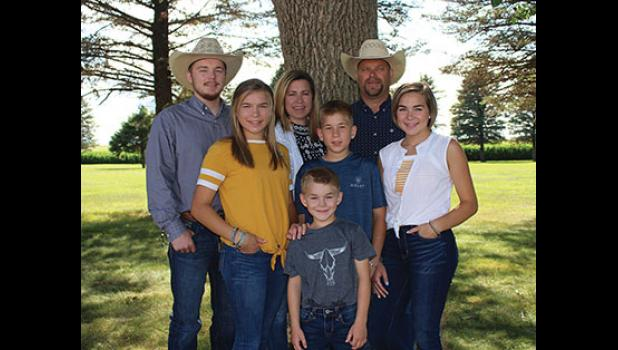 The Buntjer family: Jadon, Katrina, Maria, JohnPaul, Luke, and parents Mark and Kim in back, have been named Todd County's Farm Family of the Year.