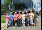 Chris Petron and Pat Gray, Christie Home Historical Society tour guides are flanked by visitors from New York Mills.