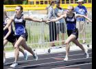Elle Olson (L) took the handoff from fellow senior Claire Liebsch (R) during the state qualifying 4x200 relay race.