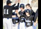 From left: Juan Paramo (11), Blake Fossland (3), Eric Hinnenkamp (24), Noah Koltes, and Hudson Pung (21) celebrate after Hinnenkamp's game winning double in extra innings last Friday.